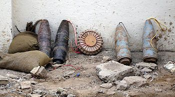 An improvised explosive device (IED) is a homemade bomb constructed and deployed in ways other than in conventional military action. It may be constructed of conventional military explosives, such as an artillery round, attached to a detonating mechanism. Roadside bombs are a common use of IEDs.