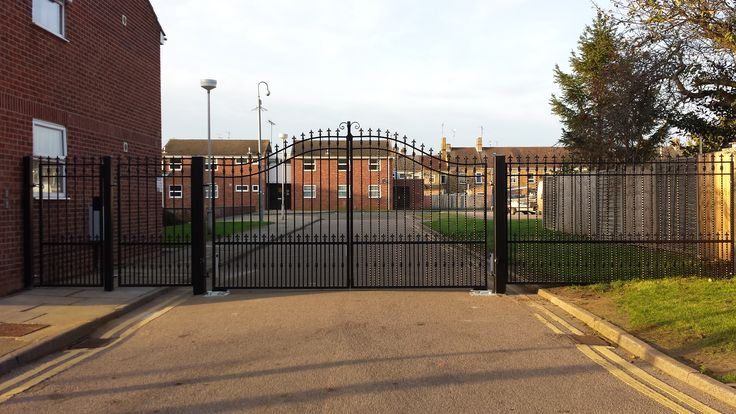 A traditional style security gate with railings and personnel gate, installed in Peterborough city centre.