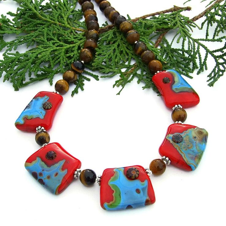 the meet me in sedona necklace features artisan handmade lampwork glass wedges in red and turquoise golden tigers eye and sterling silver southwest