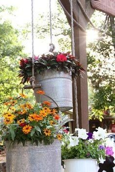 old galvanized buckets as planters hung with heavy rope....love this idea!!!!