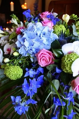 Royal blue Flower arrangement with a touch of raspberry pink for something blue bridal shower