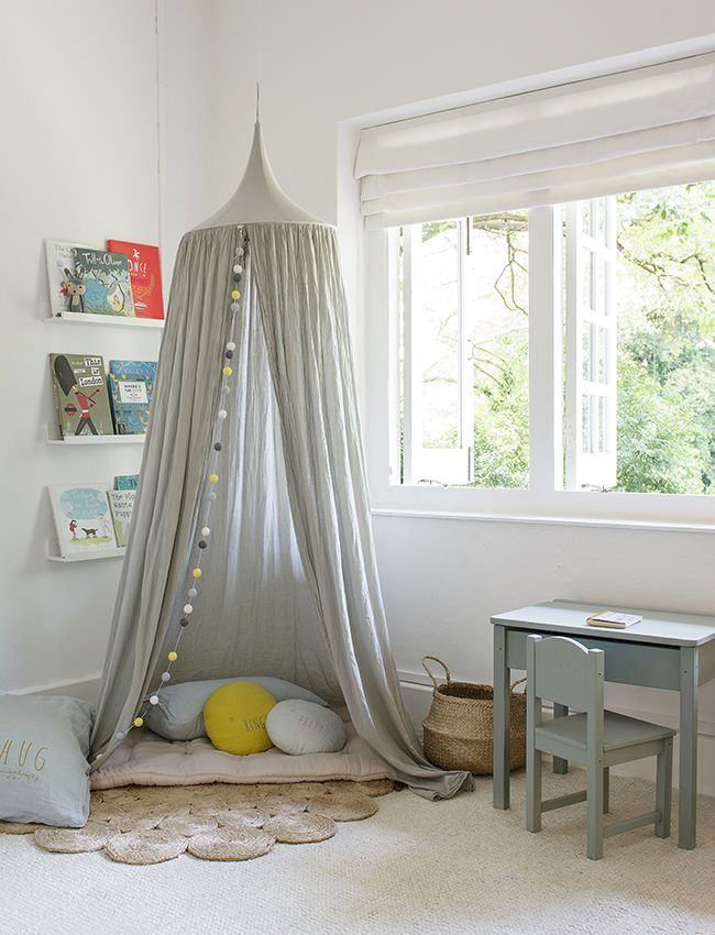 Shared children's bedroom with Numero 74 canopy in a reading corner and Armadillo & Co rugs