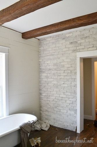 how to white wash brick- did this to my ugly old red brick around the wood stove! Love it! Able to paint the room colors I like instead of having to take that red brick into consideration! I added more water and let a little of the modeling of the brick show through. I liked the variation.