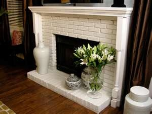 Decorate white painted brick fireplace in the living room.