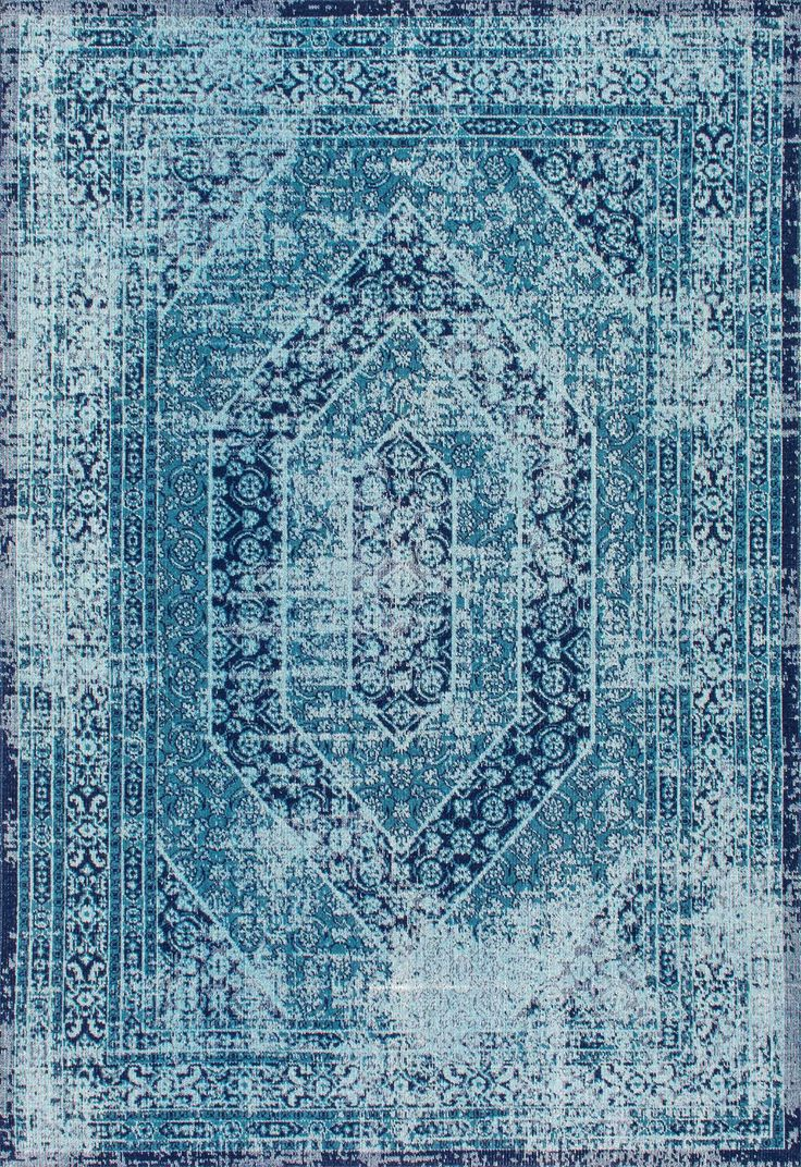 Overdyed and blue! This is Rugs USA's Seasoned SW02 Elaborate Floral Garden Hexagons Rug!