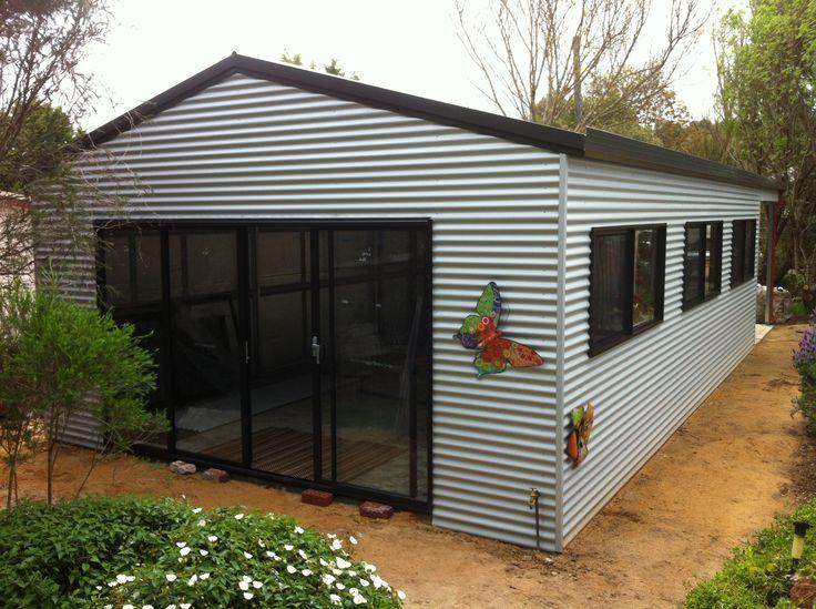Horizontally clad 6m x 9m artist's studio with  extra wide sliding doors