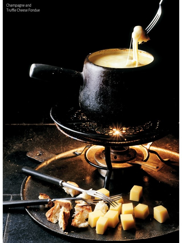 Champagne and Truffle Cheese Fondue - serve with Marilyn's GF Bubble Bread....soft, sweet and perfectly paired with fondue!