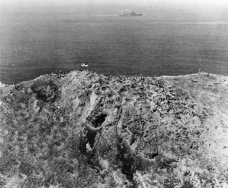 Aerial photograph of American flag atop Mount Suribachi, Iwo Jima on February 23, 1945.