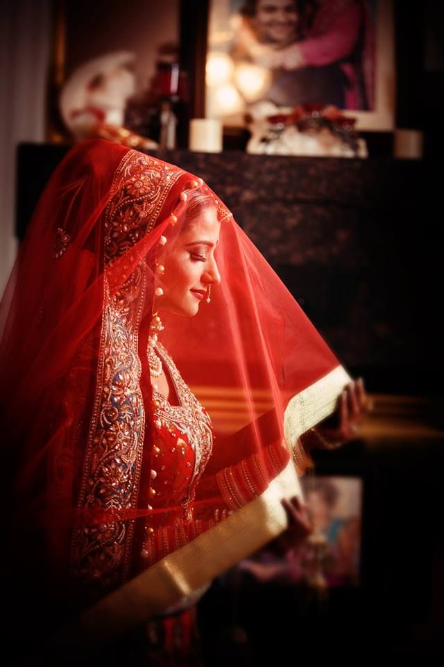 So many reasons to love this image. A truly Crimson Bride. Indian bride - Indian wedding - Sri Lankan bride - South Asian Bride - red wedding saree - red wedding dupatta - red weddind lehenga #thecrimsonbride