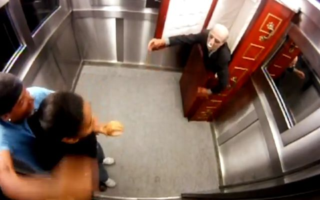 Scaring People in an Elevator With an Undead Old Man in a Coffin