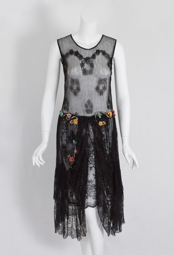 Lace flapper dress with ribbon art flowers, c.1925. The layered skirt is draped with swags over a shorter under panel of Chantilly lace. A wide panel of scalloped Chantilly lace borders the hem. The delicate floral-patterned lace is enhanced with sprays of three dimensional ribbon art flowers.
