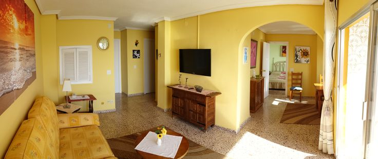 The livingroom is centrally located. To the right you'll have tyhe dining room and the master bedroom with an ensuit bathroom. The kitchen hatchet can be held open or closed. www.wonderful-calpe.webs.com