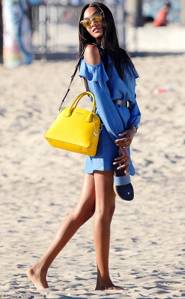 Switching it up: The beauty changed into another summer-inspired, denim ensemble...