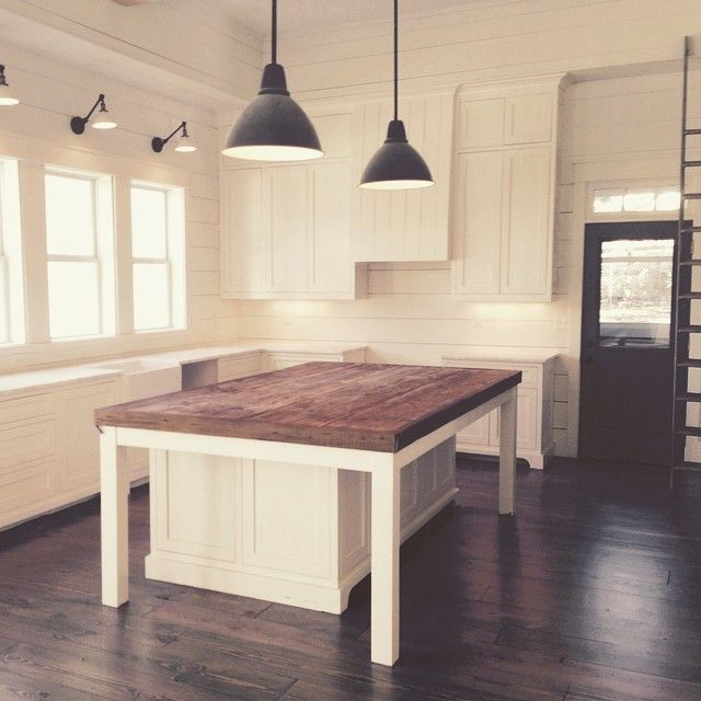 I love the white with the dark island flooring and door for Farmhouse style kitchen lighting