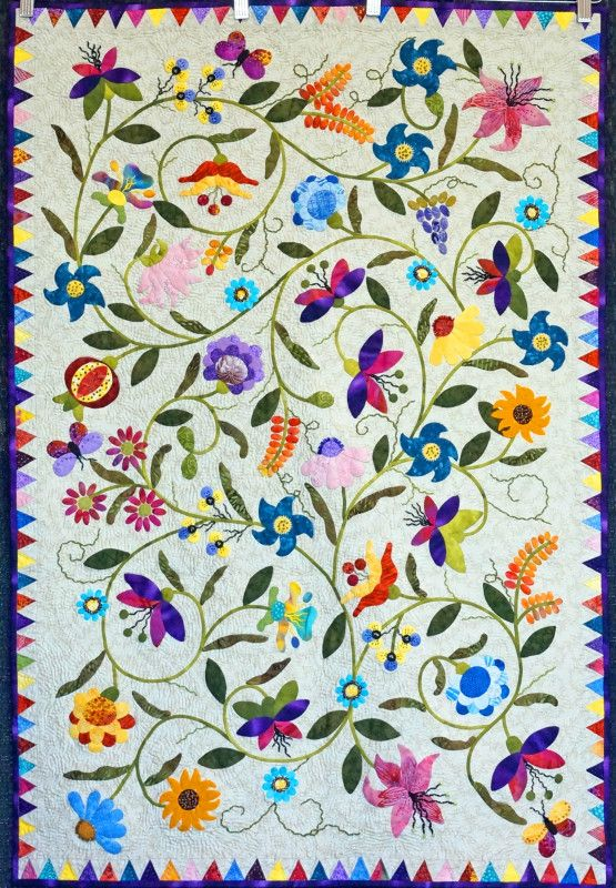 """""""Floral Sampler"""" by Janae Bissinger. 2nd place -- Small Applique by One person. 2015 Boise Basin Quilters Guild show. (Designer - Deborah Kemball.)"""