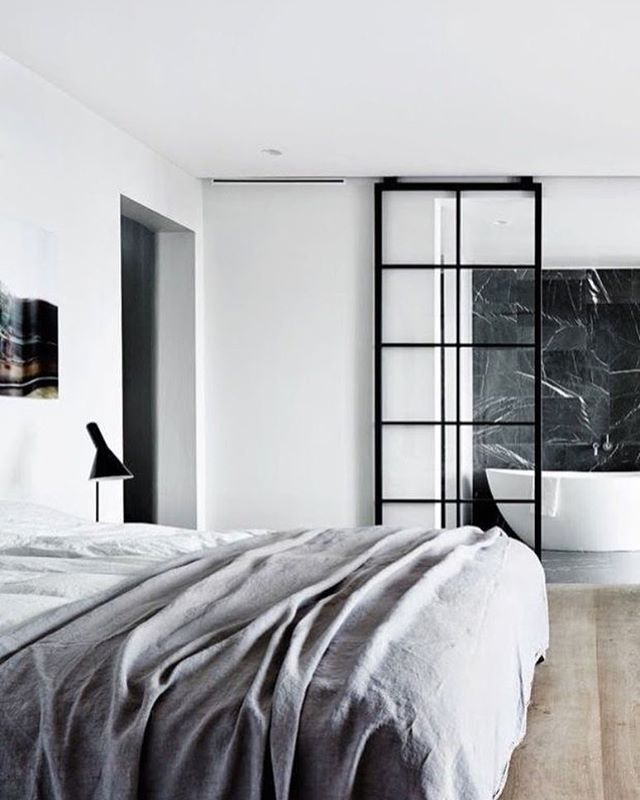 One of our favourite bedrooms! Love the iron glass panel sliding bathroom door! Image via Fantastic Frank