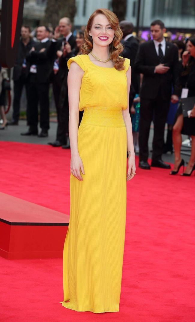 "Emma in Versace–Following up her pantsuit look earlier this week, actress Emma Stone delivered full feminine, retro glamour in an Atelier Versace gown at ""The Amazing Spider-Man 2″ premiere held in London on April 10th. The custom-made yellow gown goes perfectly with Emma's red tresses. The film star paired the look with Christian Louboutin shoes and jewelry by David Webb.   Images: Versace/Getty Related"