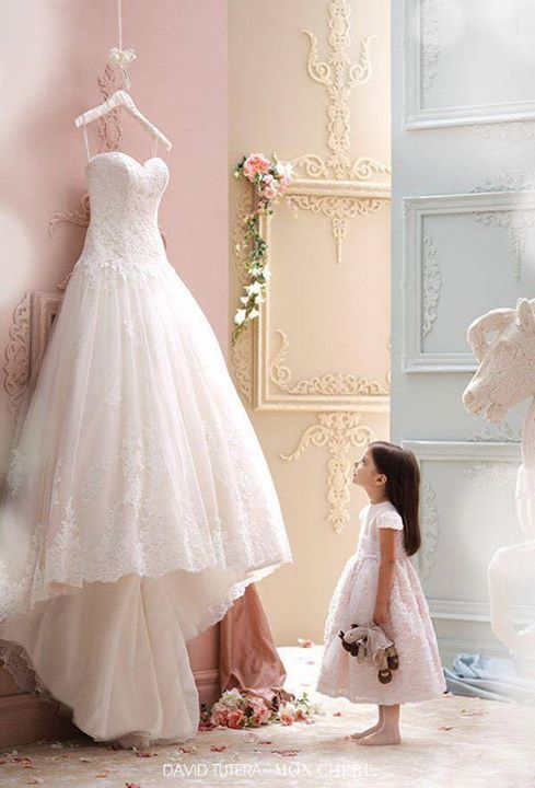 my friend came up with a story line for this so the little girl was like 5 and then her dad finally asked her mom a few days before the weeding her mom passed they decided to still hold the weeding this is her daughter looking at the dress she would have won