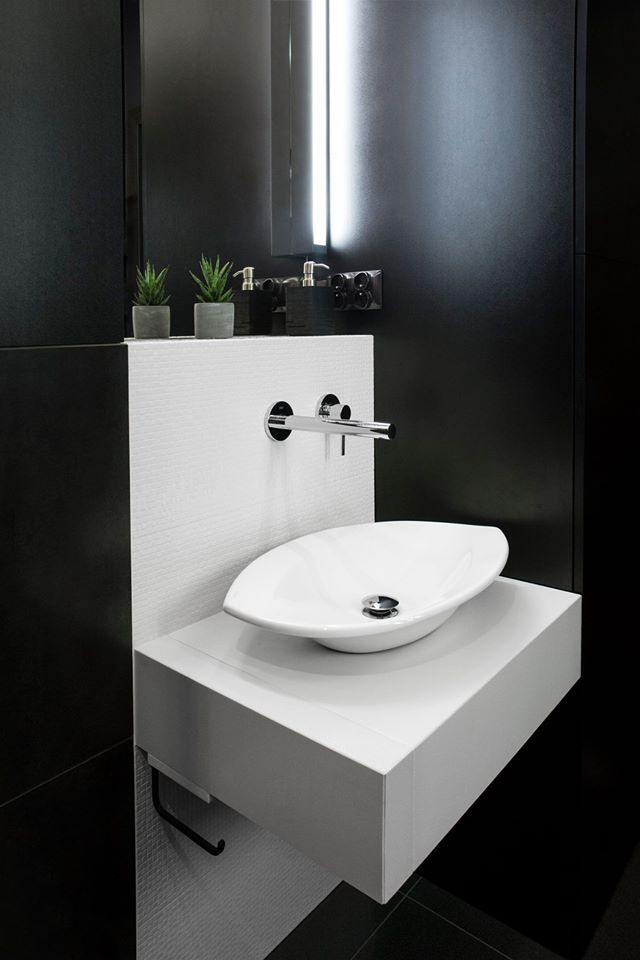 black and white bathroom. Countertop round ceramic washbasin.
