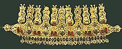 Precious hammered gilt bridal diadem from Pogoni (Epirus). The perforated finials end in heraldic birds and a talismanic head. The diadem is decorated with agates, corals, turquoise, glass-paste gems and silver elements in savati.  Late 18th century.  Athens Benaki Museum