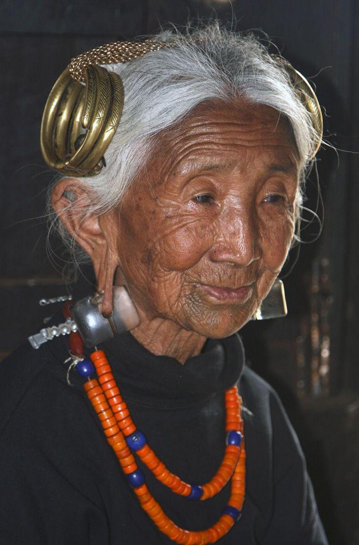 India ~ Nagaland | Elderly Ao Naga woman, at Chuchuyimlang village. | ©Walter Callens