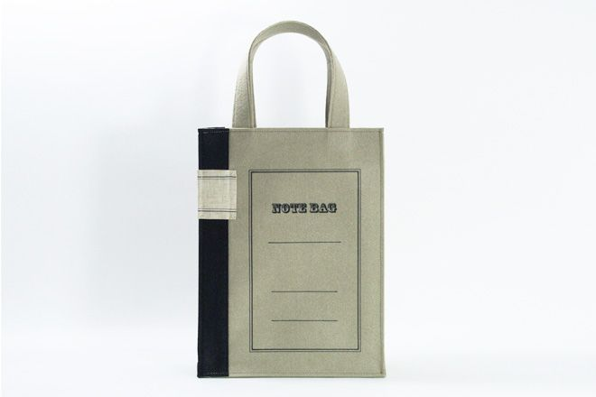 Note Bag   This is a motif of a traditional college notebook used in Japan: a bag made by felt. A notebook carries your notebooks!        Material: Felt [ Hand Printed ] Size: W250mm×H350mm×D100mm Color: BE / GR / R 2005.11 http://www.yuruliku.com/en/product/nb.html