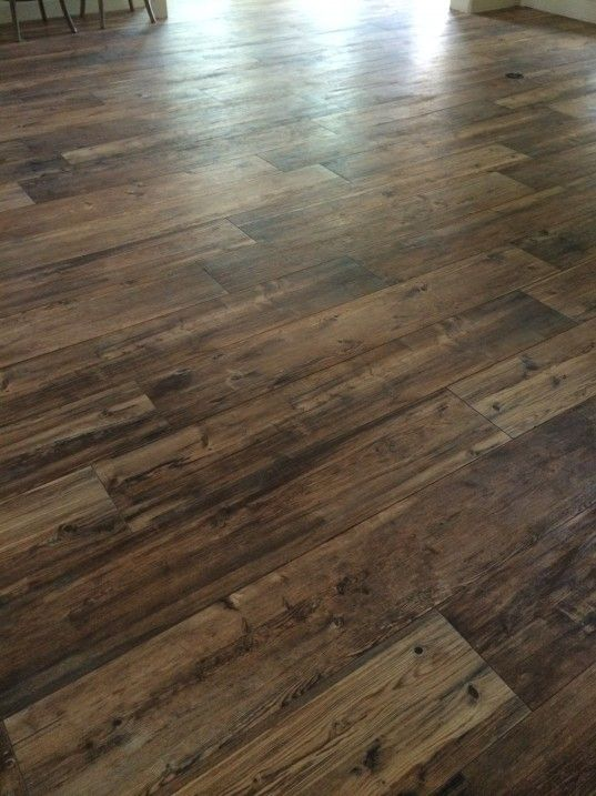 "Ceramic Wood Tile Floors - called ""Larex"" and the color is ""Sun"".  Fancy Ashley blog"