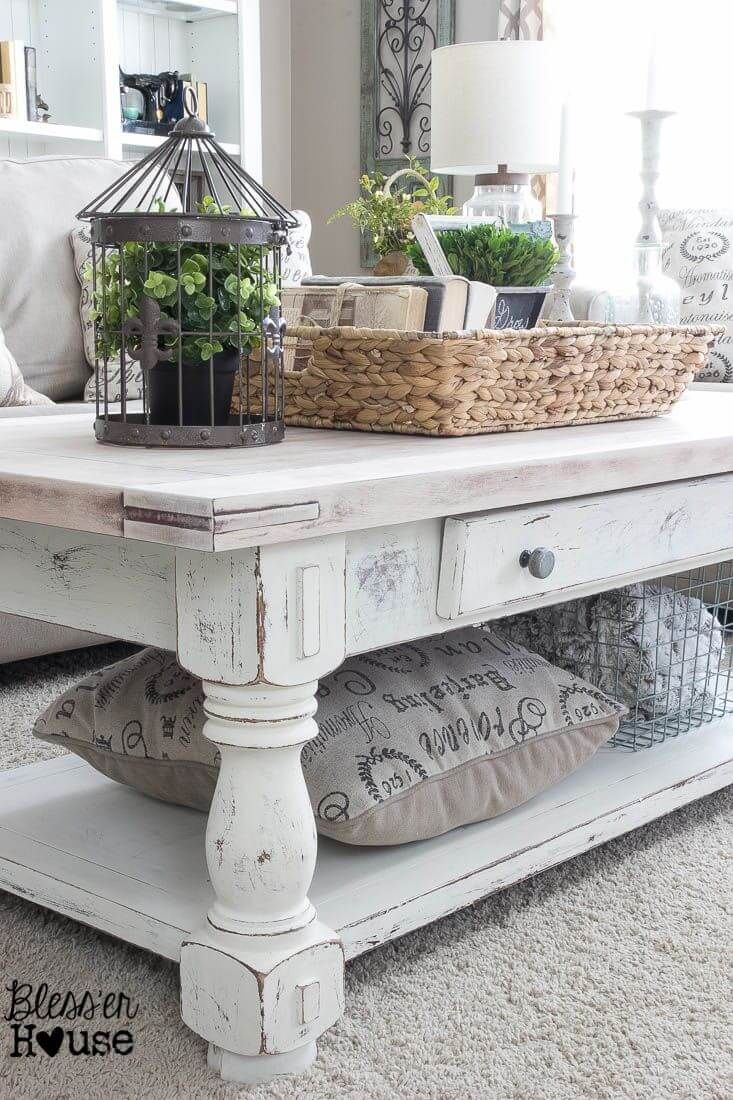 Earthy White Washed Table And Clutter Catching Raffia Basket Shabby Chic Coffee Table Chic Coffee Table Farmhouse Decor Living Room