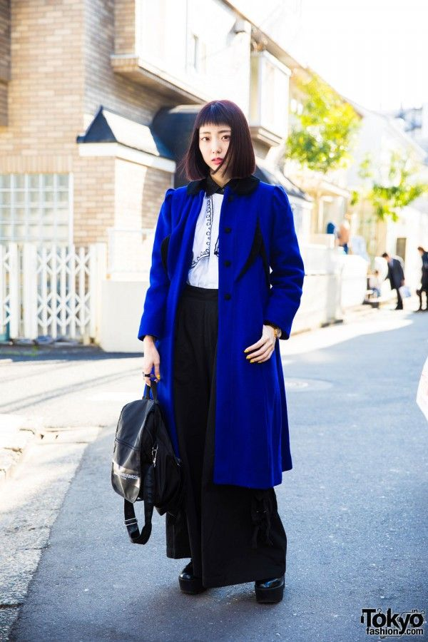 Lana is a Japanese electrical engineer we often see on the street in Harajuku. Lana's stylish ensemble consists of a black and white collar blouse from the Harajuku vintage boutique Punk Cake, black wide leg pants from Candy Stripper, an electric blue long coat from Sankaku (another Tokyo vintage shop), and black platform shoes. Her accessories include a black M.Y.O.B NYC backpack, a tattoo ring, a watch strap ring, gold watch, and yellow nail art to go along with her blunt bob with short…