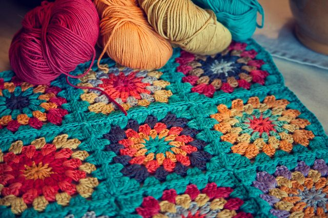 I would love to have a pretty colorful afgan like this one!  I have never been able to figure out the stitches to do anything but the basic stitch I learned in Home Ec!  So gorgeous.