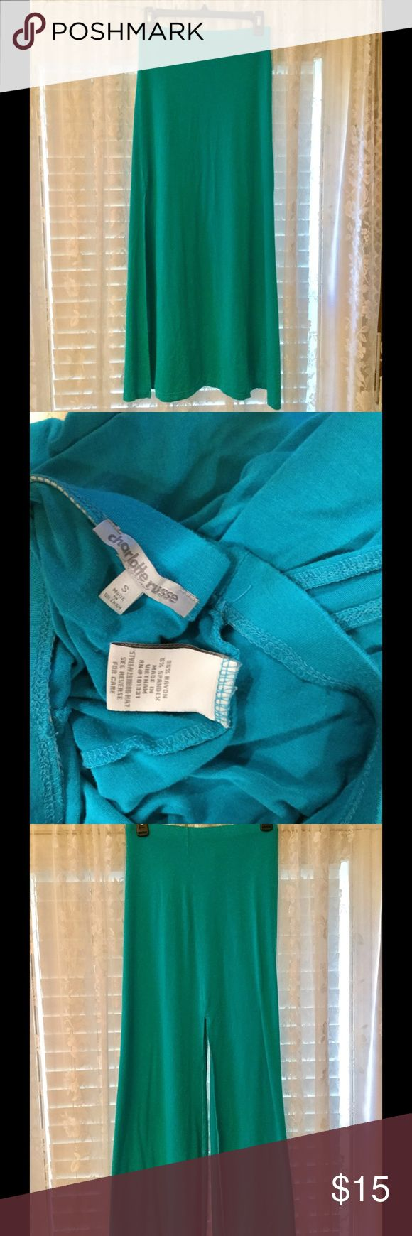 """Turquoise maxi skirt It's stretch with elastic waistband.  It is 37"""" long with side slits that are 21"""" long.  In excellent condition. Charlotte Russe Skirts Maxi"""