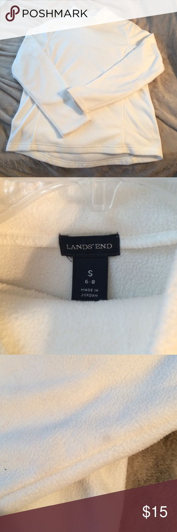 White Lands End mock neck sweater Size small, soft and comfy long sleeve sweater from Lands End that I got for Christmas! After wearing it once I realized it's a bit too big for me, mainly because I'm only 5'1. It has a couple spots that are barely noticeable but I tried my best to picture, probably from being stored until Christmas I'm assuming. Will probably easily come out. Really unnoticeable and the overall condition is almost perfect. Lands' End Tops Sweatshirts & Hoodies