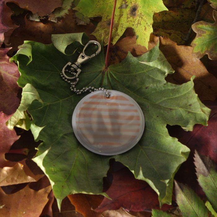 Autmn sun pedestrian reflector. #safety #pedestriansafety #reflector #govisible #besafe #pattern #accessory #reflective #design #autumn #leaves #round #stripes #orange