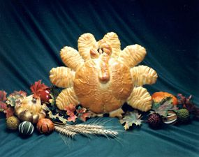 If you are looking for a cute and fun bread recipe for the Holidays, you might enjoy this Tom Turkey Thanksgiving Bread Centerpiece.
