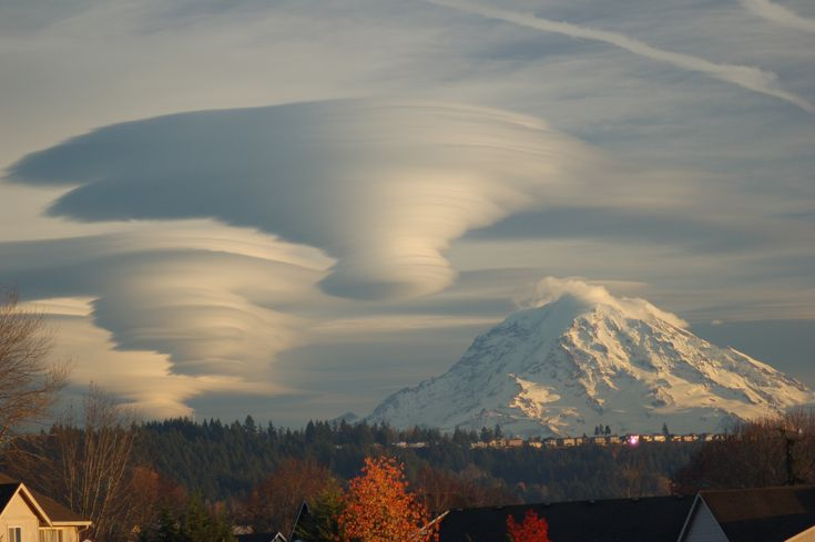 Lenticular Clouds Over Washington. Moist air forced to flow upward around mountain