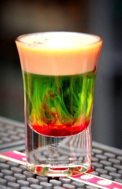 Fallen Froggie  0.5oz Midori 0.5oz Baileys Splash of grenadine  Mix equal parts and drink up!