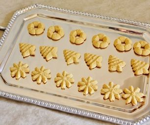 GF Spritz cookies = I am SO excited about this new recipe..... for a few reasons:  1. Baking cookies at Christmasall year roundis one of my favorite things in the whol...