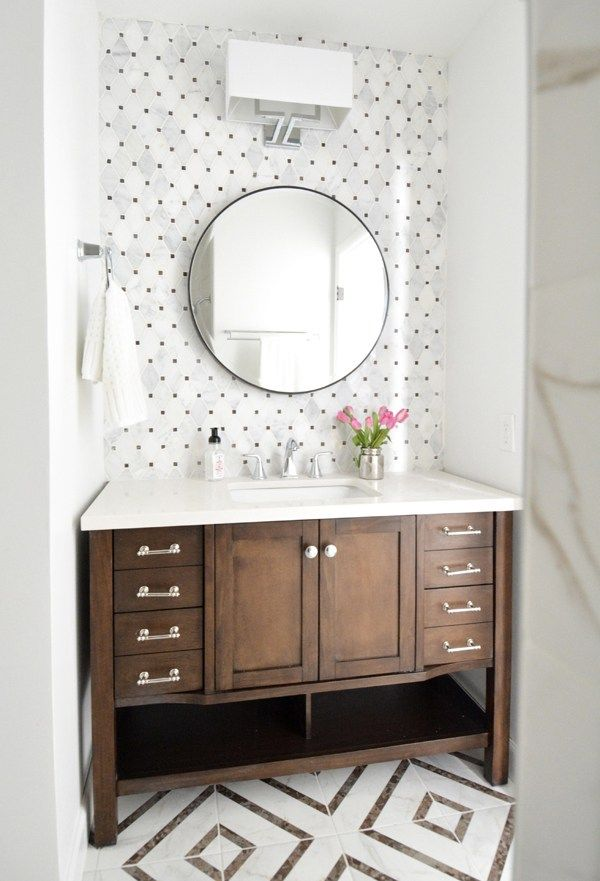 Small Hall Bathroom Makeover: brown and white shiny chrome hardware and faucet