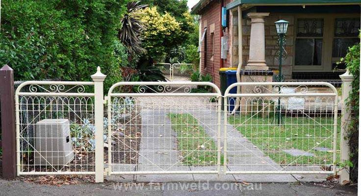 'Marie' design driveway gates with matching side fence panel graces this heritage home in Adelaide. The Victorian post capitals are sympathetic to the era of the home.  Fullarton, Adelaide, SA.