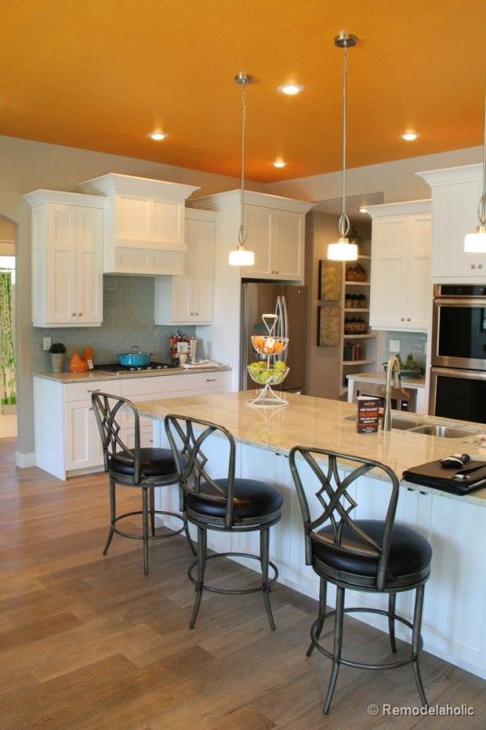 100  Interior Wall Painting Ideas - Orange ceiling in this otherwise neutral, contemporary kitchen. Love the combination of light taupe walls and the orange ceiling.