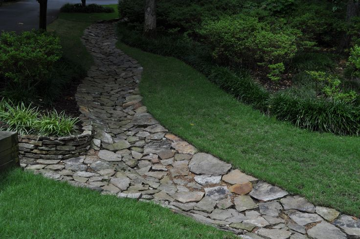 Attractive Drainage Swale | Sloped garden, Backyard ...