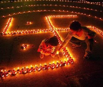 children lighting diyas on diwali... diwali is the most celebrated indian festival wich marks the return of Lord Ram to Ayodhya :) clay lamps are lit and crackers are  burst