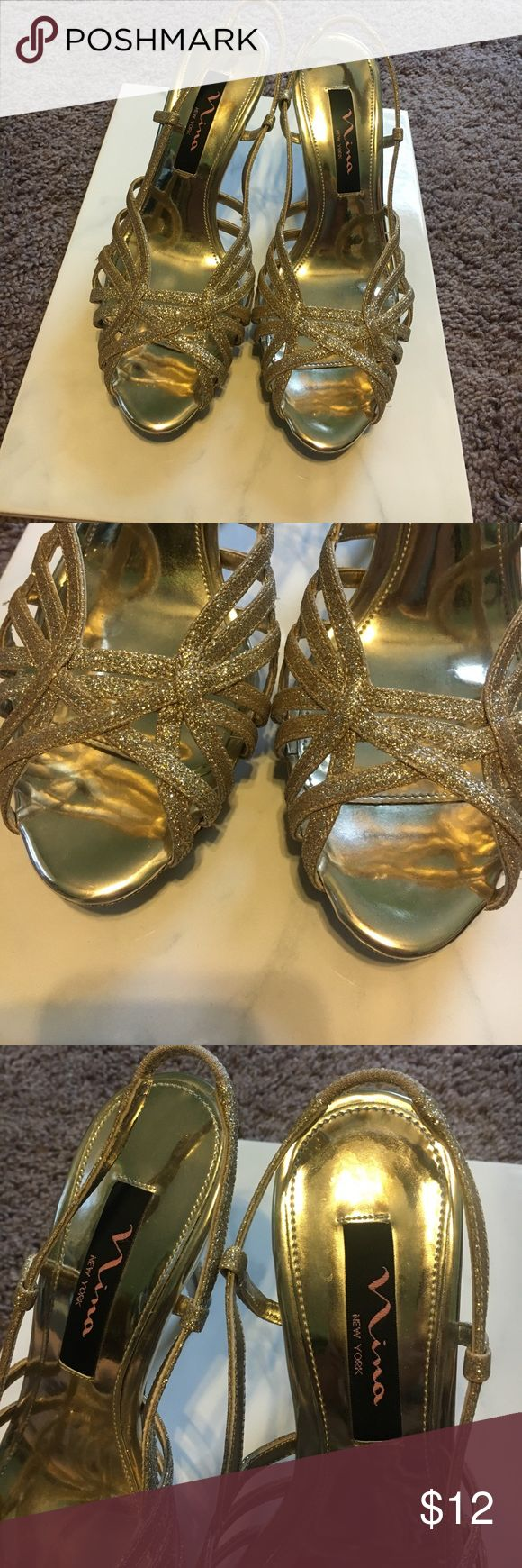 NINA SHOES GOLD SPARKLE OPEN TOE HEELS NINA SHOES GOLD SPARKLE OPRN TOE HEELS. WORN ONCE FOR PROM. Super pretty and easy to walk in due to small platform and elastic strap in the back making it easy to slip on and off. Peep toe, with leather sole. Only sign of wear is on the bottom. Sure to make any girl feel glamorous!💕 Nina Shoes Shoes Heels