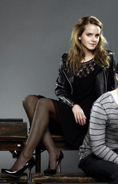 Emma Watson in black pantyhose and heels