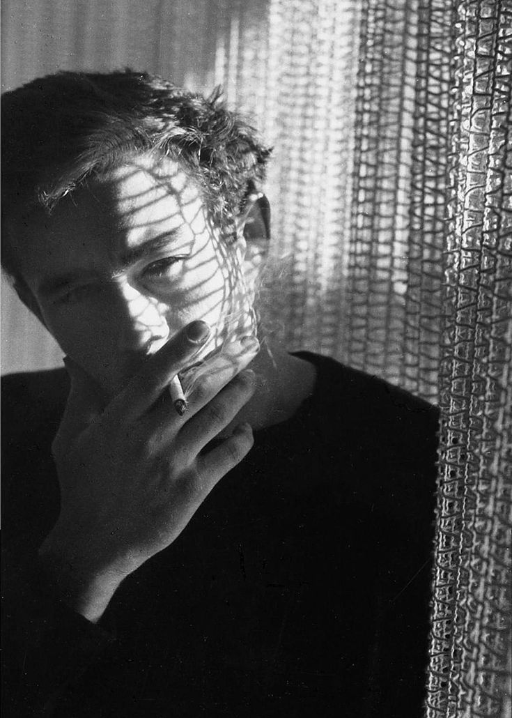"""jamesdeaner: """"   He was smoking, and I liked the way he put his cigarette to his lips, gracefully cocking his head as he inhaled, his hand covering his chin. He had a manner that made him seem manly and self-assured far beyond his years. - Liz..."""