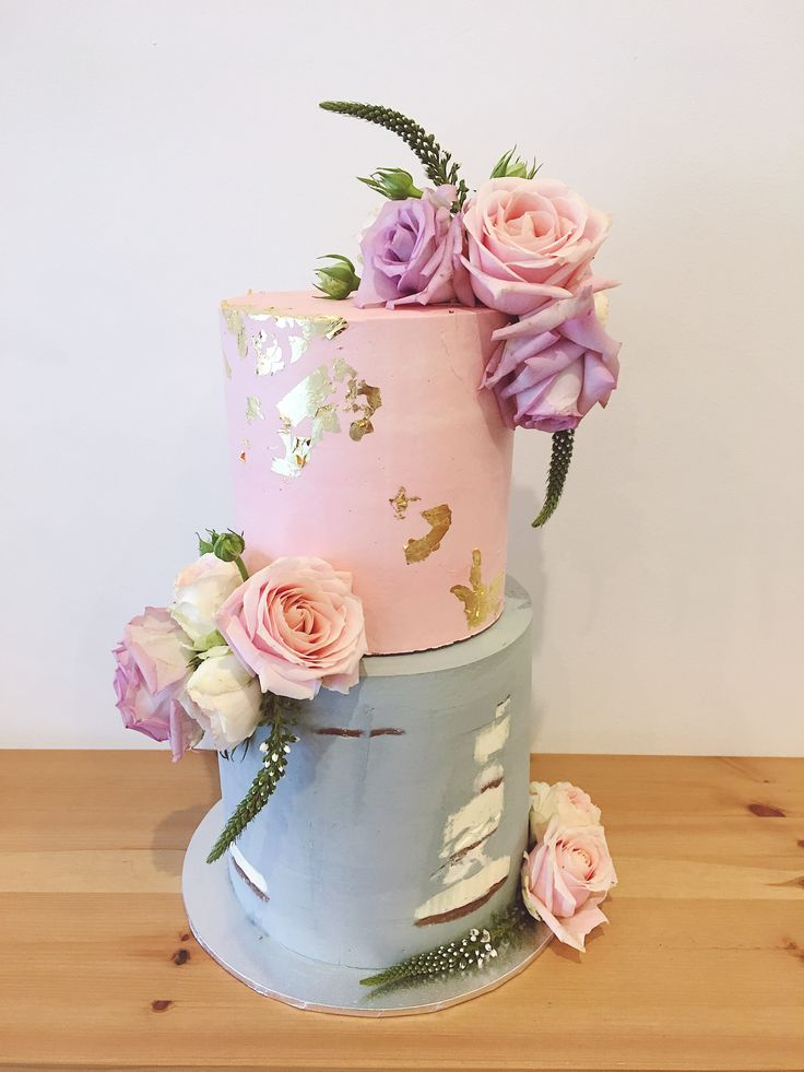 2 tier tall wedding cake- bottom tier light semi naked grey, top tier blush pink with gold foil detail. Cascading mauve, white & pink roses #haranspatisserie