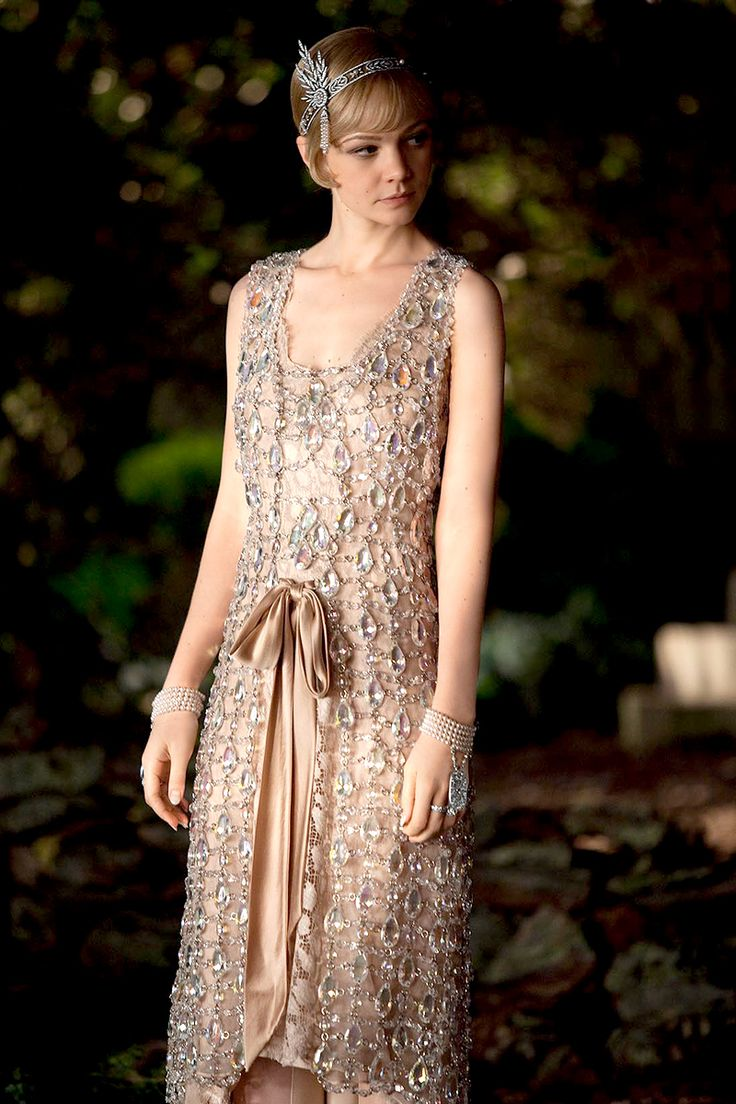The Great Gatsby (2013) | Actress Carey Mulligan (Daisy Buchanan) wearing an iconic Prada-designed crystal gown and bejeweled by Tiffany & Co.