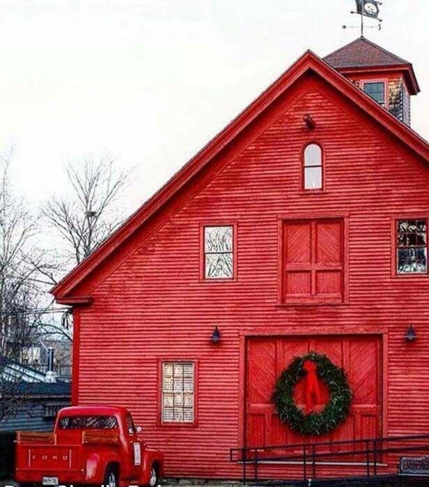 A beautiful red barn & pickup.