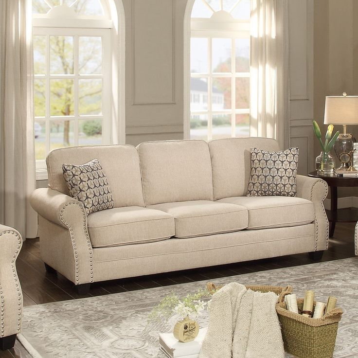 Modern traditional styling is exemplified in the design of the Bechette Collection. Recessed rolled arms feature nailhead accent for profile definition and decorative touch while contrast toss pillows lend a soft modern look to the traditional frame.