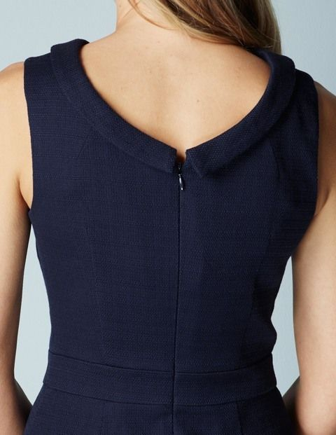Boden - Martha Dress (Navy) - By popular demand, this bestselling favourite is back – a beautifully flattering sleeveless dress with an above-the-knee cut and tailored pleats at the waist to create an hourglass silhouette. We've finished off the structured style with a rollneck collar for a modern take on femininity. Outer 98% cotton 2% elastane Lining 96% polyester 4% elastane. Machine washable. Fitted shape. Sleeveless. Length finishes just above knee. Fully lined. Concealed back zip.